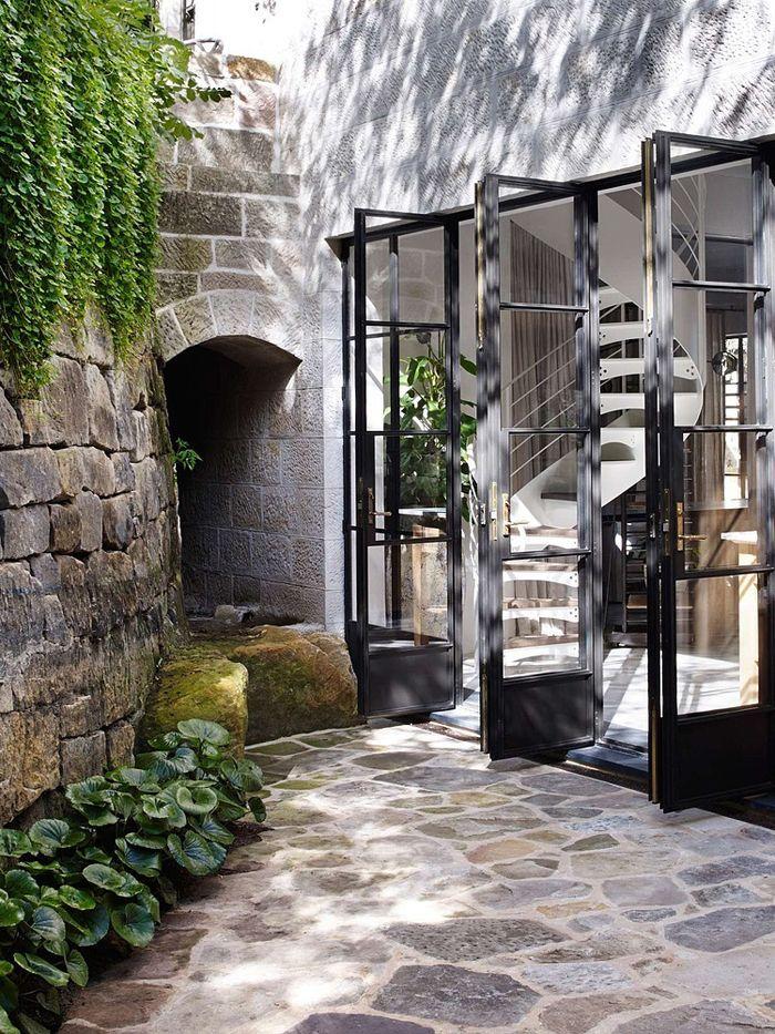 Eclectic trends it 39 s trending metal black framed room for Atrium garden window